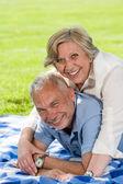 Active retirement senior couple laughing — Stock Photo