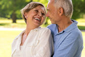 Happy retirement senior couple laughing together — Stok fotoğraf