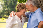 Elderly couple laughing head to head — Stock Photo
