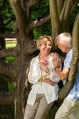 Senior couple romantic dating in park — Stock Photo