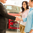 Couple making a deal with car agent — Stock Photo