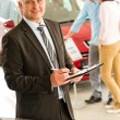 Portrait of salesman working in car dealership — ストック写真