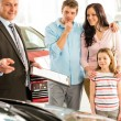 Salesman offering a family car to couple — Stock Photo