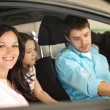 Stock Photo: Family sitting in car in retail store
