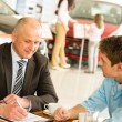 Buying family car Caucasian salesman with customer — Stock Photo #29786831