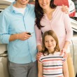 Young caucasian family with their new car — Stock Photo