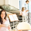 Customer drinking coffee in car dealership — Stock Photo #29786855