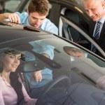 Caucasian couple choosing car — Stock Photo