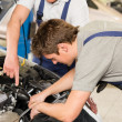 Stock Photo: Middle aged car repairman helping colleague