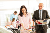 Woman choosing the color of family car — Stock Photo