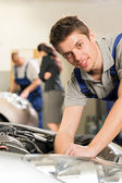Portrait of mechanic repairing car — Stock Photo
