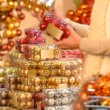 Buyer shopping Christmas balls in plastic boxes — Stock Photo #31303847