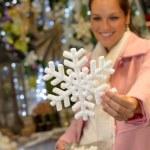 Woman purchasing Christmas snowflake ornament shop — Stock Photo #31303935