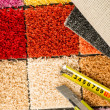 Carpet swatches, tape measure, boxcutter — Stock Photo
