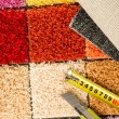 Carpet swatches, tape measure, boxcutter — Stockfoto