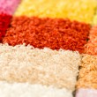 A variety of colorful carpet swatches — Stock Photo