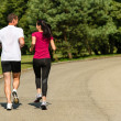 Rear view of jogging caucasian couple — Stock Photo #31302311