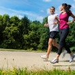 Portrait of fit couple running outdoors — Stock Photo #31302321
