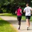 Rear view of caucasian runners outdoors — Stock Photo #31302351