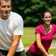 Close up portrait of couple stretching outdoors — Stock Photo