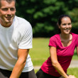 Stock Photo: Close up portrait of couple stretching outdoors