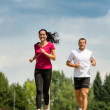 Couple friends running a race in park — Stock Photo #31302451