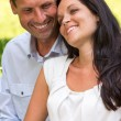 Close up portrait of young happy couple — Stok fotoğraf