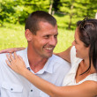 Portrait of young Caucasian couple outdoors — Stockfoto