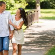 Cheerful Caucasian couple walking outdoors — Stockfoto #31302569