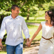 Couple walking and laughing in a park — Stock Photo