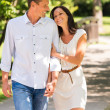 Young happy couple embracing in park — Stock Photo