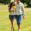 Stock Photo: Young couple walking in park barefoot