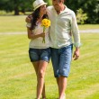 Young couple walking in park barefoot — Stock Photo