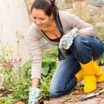 Smiling woman plant flowerbed hobby garden autumn — Stock Photo