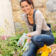 Woman gardening autumn flowers yard housework — Stock fotografie