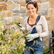 Stock Photo: Happy womclipping bush garden hobby clippers