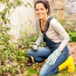 Stock Photo: Smiling woman gardening yard fall hobby housework