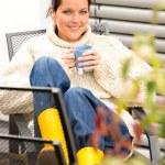 Happy woman relaxing cup tea sitting backyard — Stock Photo