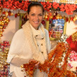 Happy woman shopping Christmas tinsel ornaments — 图库照片