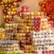Pile of shiny Christmas balls in boxes — Stock Photo #31303833