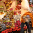 Blurry woman buyer shopping Christmas decorations — ストック写真