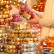 Buyer shopping Christmas balls in plastic boxes — Stock Photo