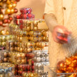 Customer shopping Christmas decorations balls — Stock Photo