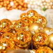 Foto Stock: Glittering golden Christmas balls decoration