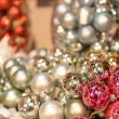 Foto Stock: Glittering silver and pink Christmas baubles