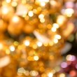 Stock Photo: Blurred glittering gold Christmas background