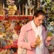 Stock Photo: Woman shopping Christmas decorations festive mood
