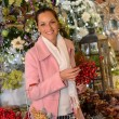 Cheerful woman shopping Christmas decorations — Stock Photo