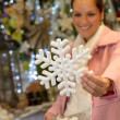 Woman purchasing Christmas snowflake ornament shop — Stock Photo #31303935