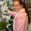 Young woman shopping Christmas decorations in coat — Stock Photo #31303939